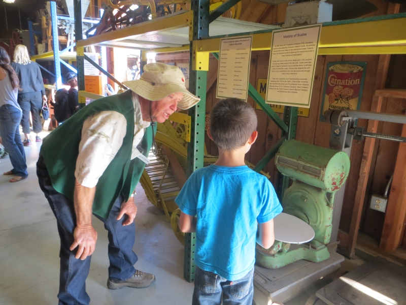 2014SCCF 227  Explaining old farm implements.JPG